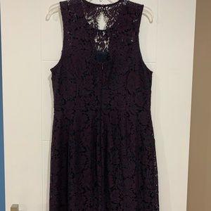 Deep purple knee length dress. Open back detail.